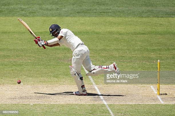 Cheteshwar Pujara of India bats during day three of the First Test match between Australia and India at Adelaide Oval on December 11 2014 in Adelaide...