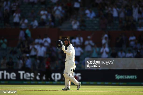 Cheteshwar Pujara of India celebrates after reaching his century during day one of the First Test match in the series between Australia and India at...