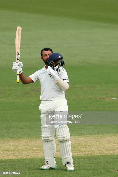 Cheteshwar Pujara of India celebrates after reaching his century during day one of the Fourth Test match in the series between Australia and India at...