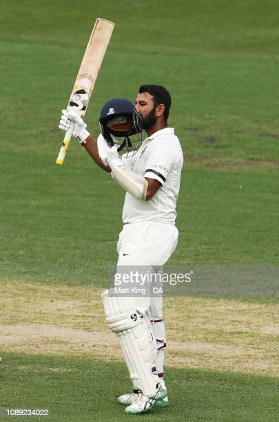 Cheteshwar Pujara of India celebrates and acknowledges the crowd after scoring a century during day one of the Fourth Test match in the series...