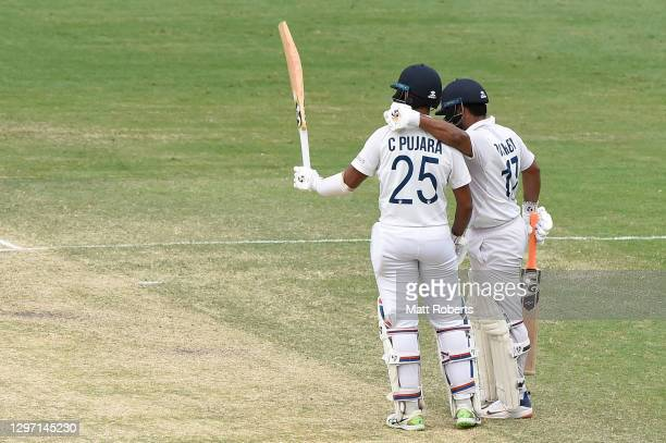 Cheteshwar Pujara of India celebrates his half century during day five of the 4th Test Match in the series between Australia and India at The Gabba...