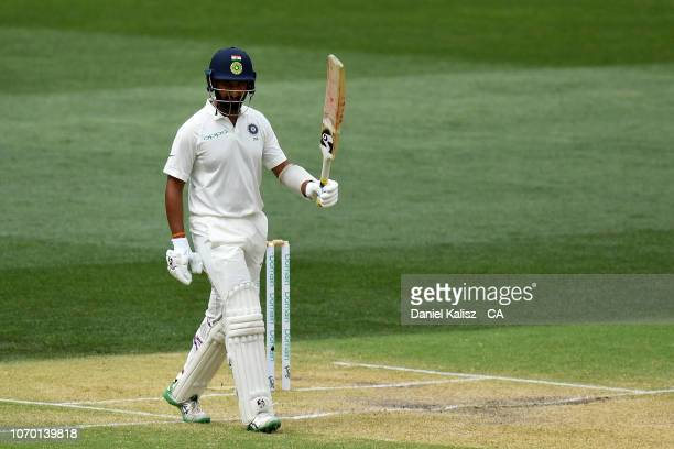 Cheteshwar Pujara of India celebrates reaching his half century during day four of the First Test match in the series between Australia and India at...