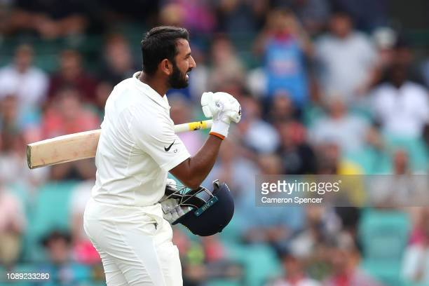 Cheteshwar Pujara of India celebrates scoring a century during day one of the Fourth Test match in the series between Australia and India at Sydney...