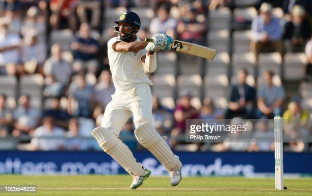 Cheteshwar Pujara of India hits out during the second day of the fourth Specsavers Test Match between England and India at The Ageas Bowl on August...