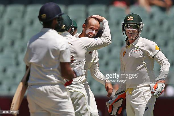 Cheteshwar Pujara of India is bowled by Nathan Lyon of Australia who celebrates during day three of the First Test match between Australia and India...