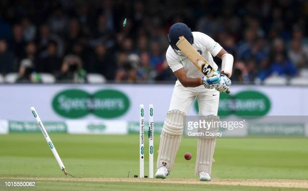 Cheteshwar Pujara of India is bowled by Stuart Broad of England during day four of the 2nd Specsavers Test between England and India at Lord's...
