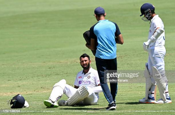 Cheteshwar Pujara of India is seen to by a medic after being struck by the ball during day five of the 4th Test Match in the series between Australia...