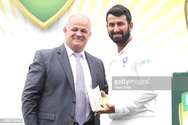 Cheteshwar Pujara of India poses with the Player of the Series trophy during the presentation after day five of the Fourth Test match in the series...