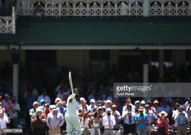 Cheteshwar Pujara of India raises his bat as he leaves the ground after being dismissed for 193 runs during day two of the Fourth Test match in the...