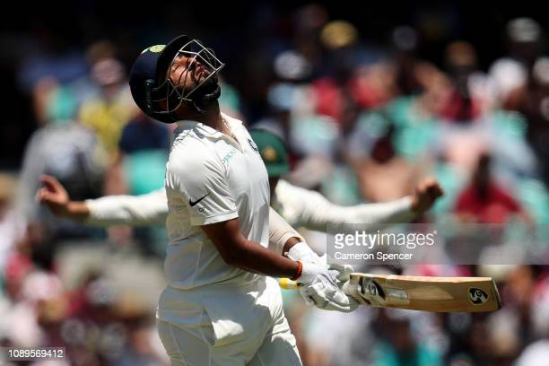 Cheteshwar Pujara of India reacts after being dismissed by Nathan Lyon of Australia during day two of the Fourth Test match in the series between...