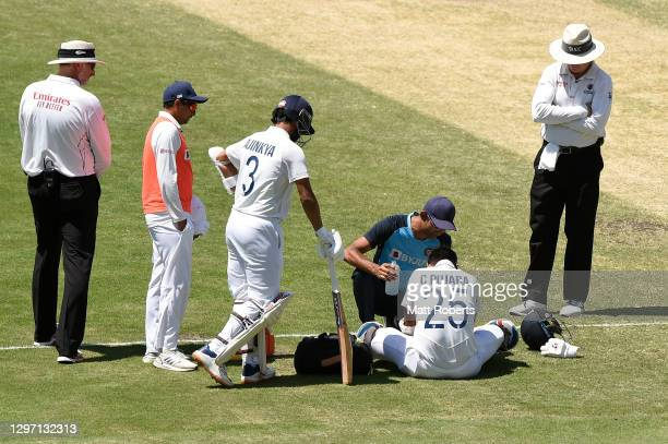 Cheteshwar Pujara of India receives attention on the field during day five of the 4th Test Match in the series between Australia and India at The...
