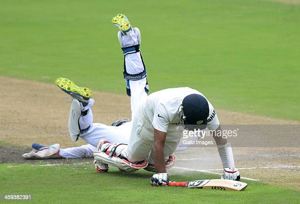 Cheteshwar Pujara of India tumbles over AB de Villiers of South Africa during day 1 of the 2nd Test match between South Africa and India at Sahara...