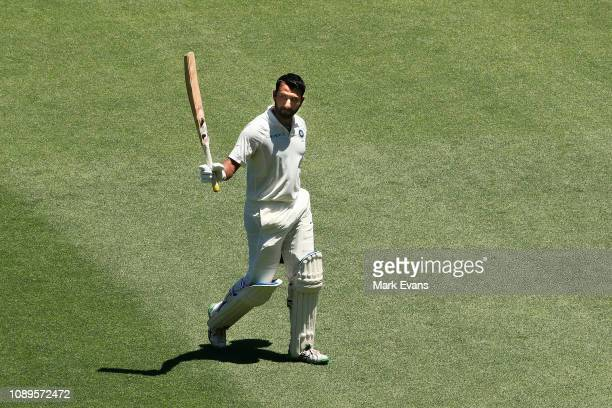 Cheteshwar Pujara of India walks off after he was caught and bowled by Nathan Lyon of Australia during day two of the Fourth Test match in the series...