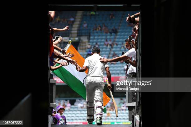Cheteshwar Pujara of India walks out to bat during day two of the Third Test match in the series between Australia and India at Melbourne Cricket...
