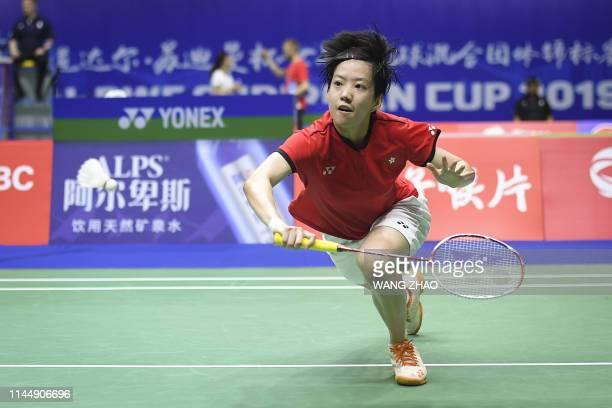 TOPSHOT Cheung Ngan Yi of Hong Kong returns to Tai Tzu Ying during their women's singles match of the 2019 Sudirman Cup world badminton championships...