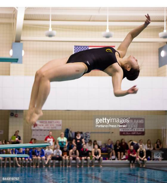 Cheverus diver Nina Greenwood makes one of three dives that won her an individual championship in the 1 meter event during the Class A girls swimming...