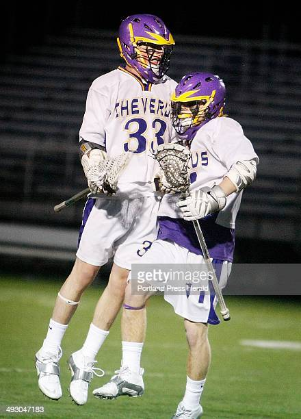 Cheverus Patrick Sullivan and Jack Sutton celebrate Sutton's goal in the first quarter of boys' lacrosse action vs Thornton Academy at Deering High...