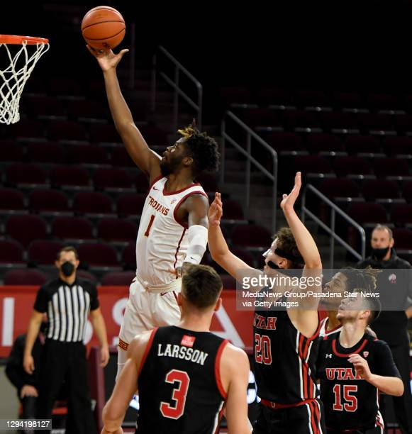 Chevez Goodwin of the USC Trojans drives to the basket against the Utah Utes In the first half of a NCAA basketball game at Galen Center on the...