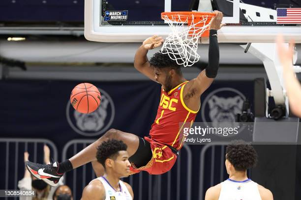 Chevez Goodwin of the USC Trojans dunks the ball against the Kansas Jayhawks in the second half of their second round game of the 2021 NCAA Men's...