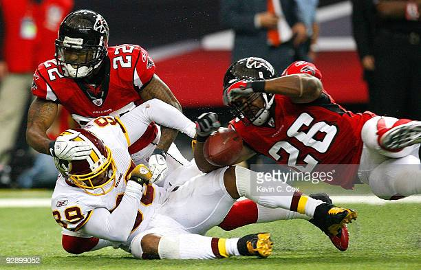 Chevis Jackson of the Atlanta Falcons defends as Erik Coleman breaks up a pass intended for Santana Moss of the Washington Redskins at Georgia Dome...