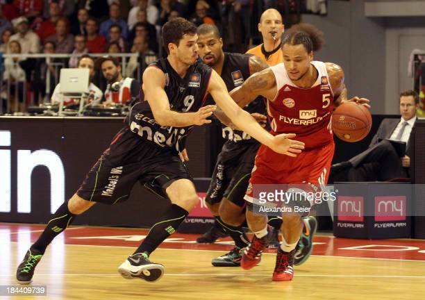 Chevon Troutman of Bayern Muenchen fights for the ball with Nicolai Simon of medi Bayreuth during the Basketball Bundesliga match between FC Bayern...