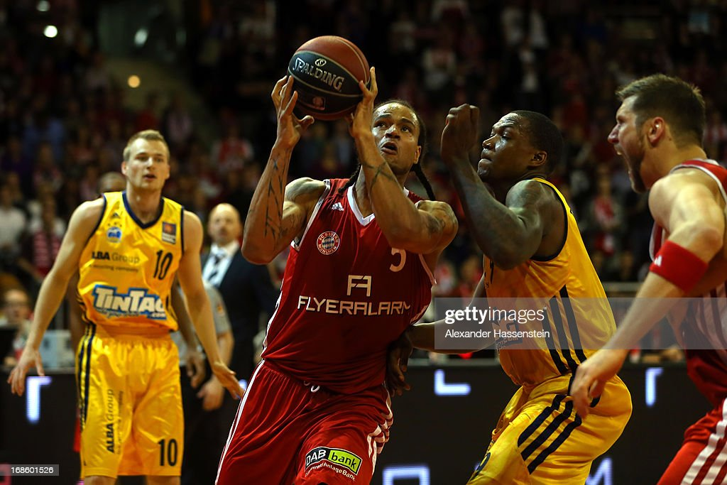 Chevon Troutman of Berlin shoots against Deon Thompson of Berlin during Game 3 of the quarterfinals of the Beko Basketball Playoffs between FC Bayern Muenchen and ALBA Berlin at Audi-Dome on May 12, 2013 in Munich, Germany.