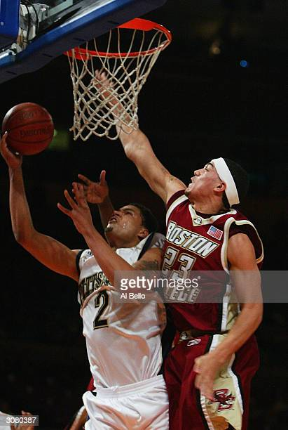 Chevon Troutman of Pittsburgh Pantjers shoots against Sean Marshall of Boston College Golden Eagles during their Semi Final game of the Big East...