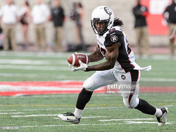 Chevon Walker of the Ottawa Redblacks runs with the ball during the CFL game against the Montreal Alouettes at Percival Molson Stadium on June 25...