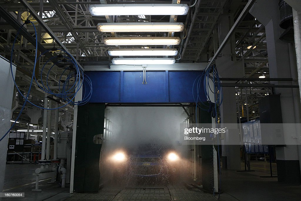 A Chevrolet Aveo automobile, a division of General Motors Co. (GM), is washed during a windscreen wiper test on the production line at the GAZ Group plant in Niznhy Novgorod, Russia, on Tuesday, Feb. 5, 2013. GAZ, which is controlled by Russian billionaire Oleg Deripaska, plans to make 30,000 Aveo sedans and hatchbacks a year at its plant in Nizhny Novgorod starting in mid-2012. Photographer: Alexander Zemlianichenko Jr./Bloomberg via Getty Images