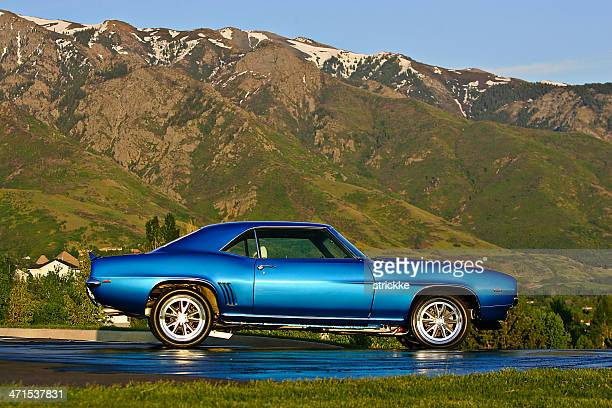 1967 chevrolet camaro ss at rest with mountainous background - camaro stock photos and pictures