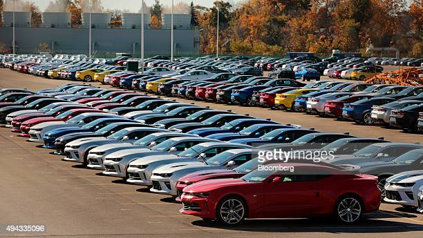 Chevrolet Camaros sit parked outside before being shipped to dealers from the General Motors Co Lansing Grand River Assembly plant in Lansing...