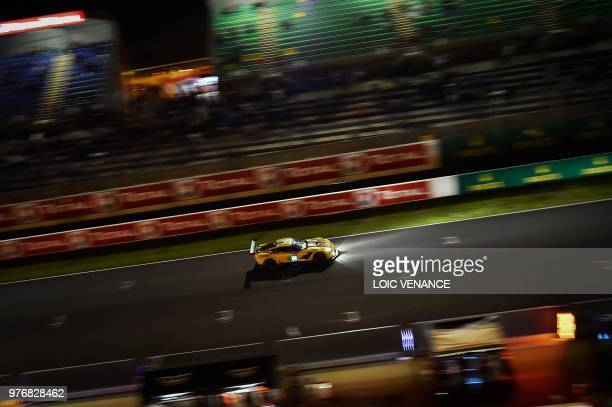 Chevrolet Corvette C7R Swiss driver Marcel Fassler competes during the 86th Le Mans 24hours endurance race at the Circuit de la Sarthe at night on...