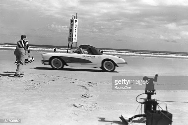 Chevrolet Corvette convertible takes the checkered flag after making a speed trial run on the Daytona Beach Road Course