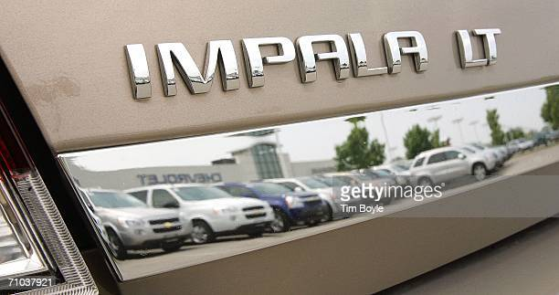 Chevrolet Impala LT logo is seen on a new Impala at Bredemann Chevrolet May 24 2006 in Park Ridge Illinois General Motors has offered gas...