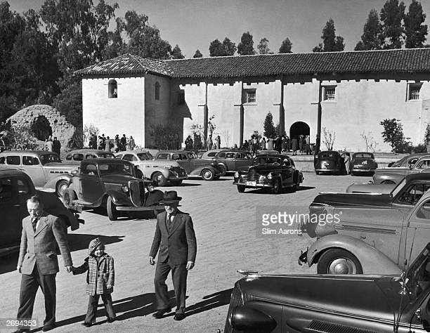 Chevrolet Master Series De Luxe and 1936 Studebaker President with a fastback Buick in the centre and an early hot rod turning towards the camera in...