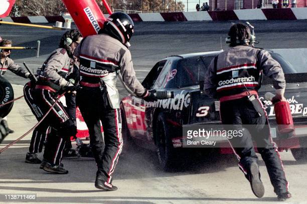 Chevrolet of Dale Earnhardt makes a pit stop during the Atlanta Journal 500 NASCAR Winston Cup race Atlanta Motor Speedway on November 18 1990 in...
