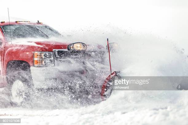 chevrolet pick-up truck plowing fresh snow - snowplow stock pictures, royalty-free photos & images