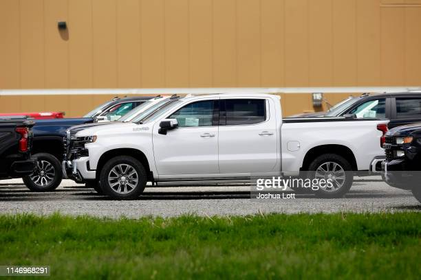 Chevrolet pickup trucks sit in a parking lot outside the GM Fort Wayne Assembly Plant on May 30 2019 in Roanoke Indiana General Motors Chairman and...