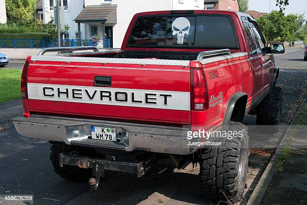 chevrolet pick-up with big tires - monster truck stock pictures, royalty-free photos & images