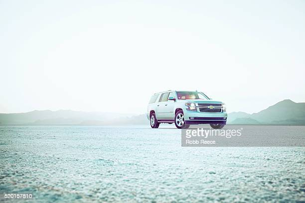 chevrolet suburban at sunset at bonneville salt flats, utah - robb reece stock pictures, royalty-free photos & images