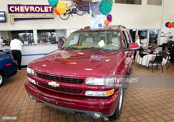 Chevrolet Suburban sport utility vehicle sits in the showroom of a suburban Chicago dealership April 25 2005 in Schaumburg Illinois General Motors...
