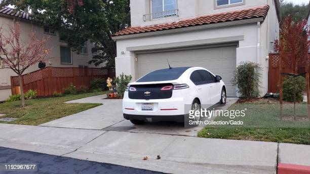 Chevrolet Volt electric car parked on the driveway of a suburban home, San Ramon, California, November 28, 2019.