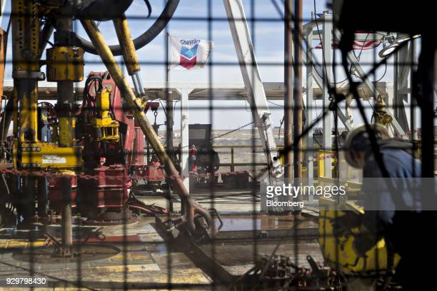 A Chevron Corp flag flies on the drilling floor of a Nabors Industries Ltd drill rig in the Permian Basin near Midland Texas US on Thursday March 1...