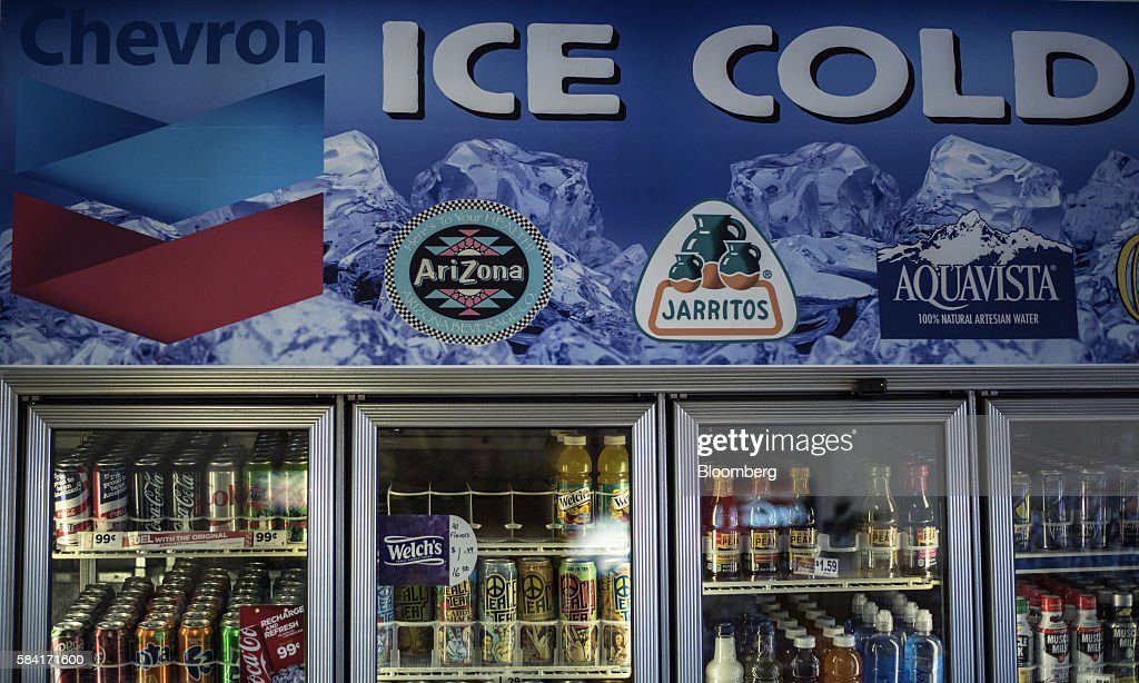 A Chevron Corp  sign is displayed above the cooler inside a