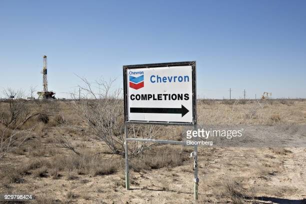 A Chevron Corp sign stands along a lease road near an oil rig in the Permian Basin near Midland Texas US on Thursday March 1 2018 Chevron the world's...