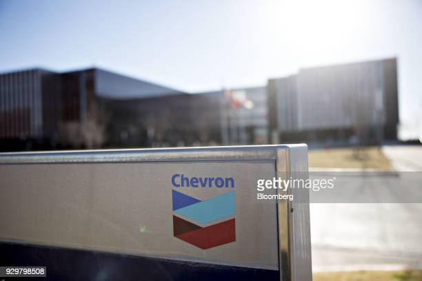 Chevron Corp signage is displayed outside an office building in Midland Texas US on Thursday March 1 2018 Chevron the world's thirdlargest publicly...