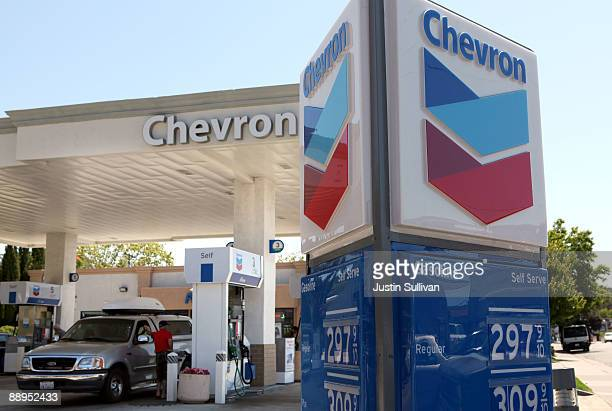 Chevron customer looks under the hood of his car at a Chevron service station July 9 2009 in San Rafael California Chevron will report quarterly...