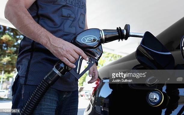 Chevron customoer Jason Glavis prepares to pump gas into his car at a Chevron gas station August 13 2010 in San Rafael California US retail sales...