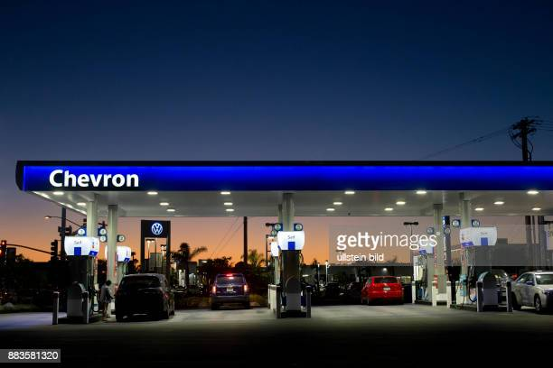 Chevron gas station standing out against the dawning sky after the sunset