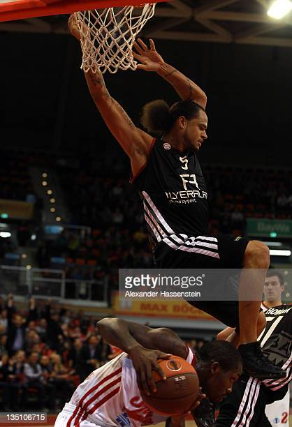Chevron Troutman of Muenchen battles for the ball with Patrick Beverley of St Petersburg during the Eurocup Basketball match between FC Bayern...